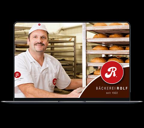 MacBook Pro Mockup mit Auslieferungsfahrer der Bäckerei Rolf